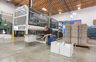 man working on mechanical packaging system